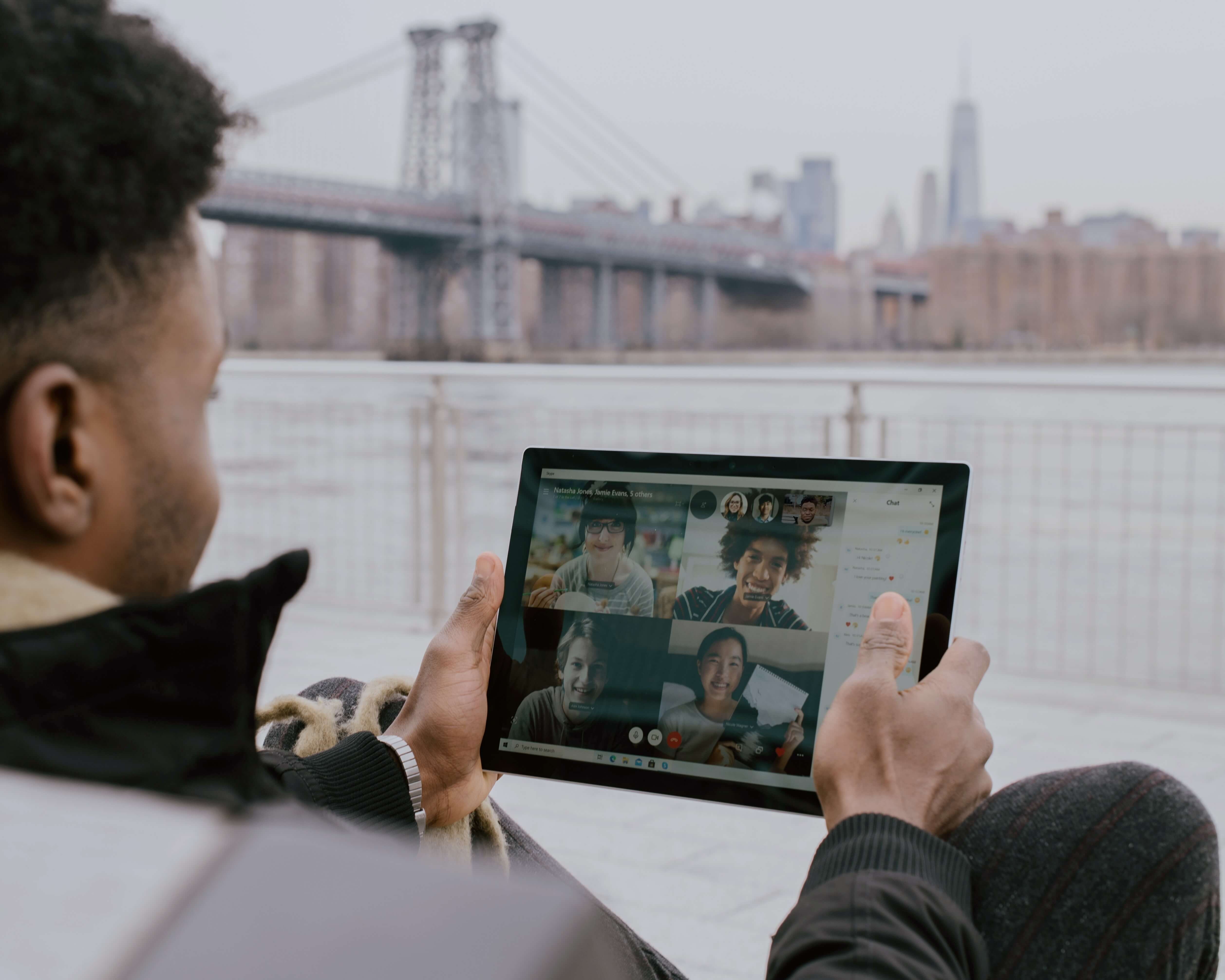 photo of someone on a micrsoft teams meeting on a Surface tablet - photo by Surface on Unsplash